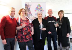 Image shows CEO Stephen Mathews and Deputy CEO Eileen Thomson with User Forum reps getting awards for service.