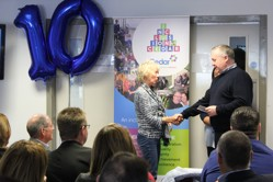 Image shows Dr Nan Hill OBE presenting Alex with length of service award.